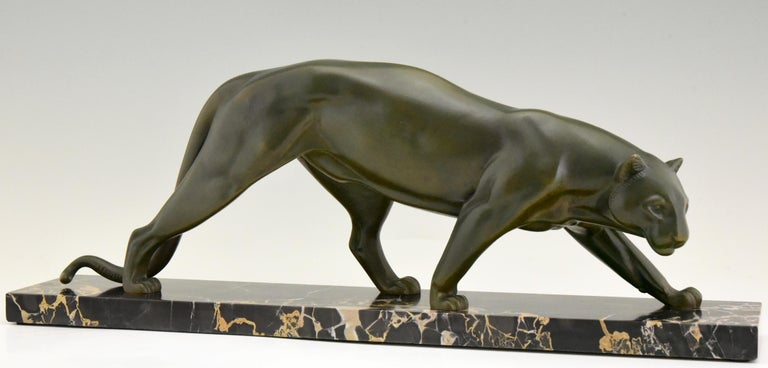 Impressive Art Deco bronze of a panther by the French artist Irenee Rochard, circa 1930. The bronze sculpture has a beautiful patina and stands on a Portor marble base.