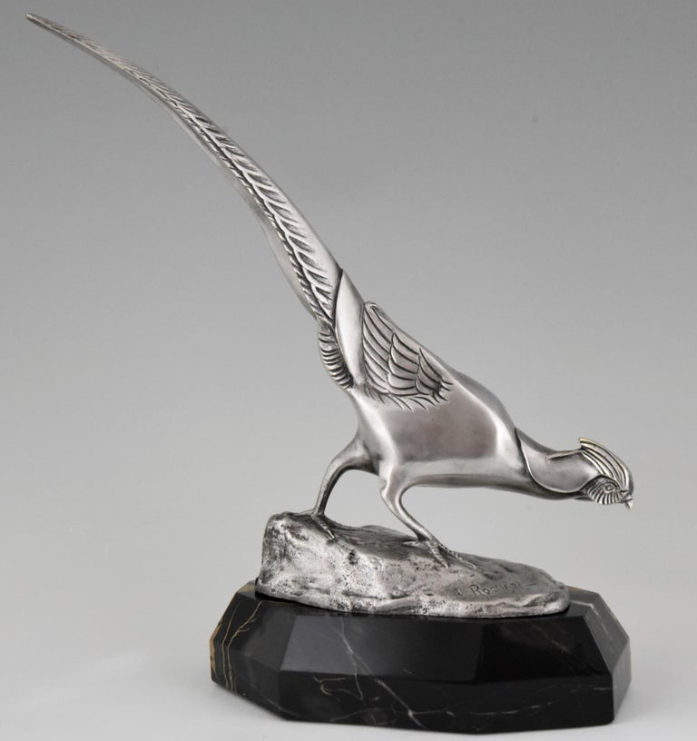 """Very nice bronze Art Deco sculpture of a pheasant with lovely silver patina, mounted on a Portor marble base. Signed by Irenee Rochard, France, 1925. """"Animals in bronze"""" by Christopher Payne. Antique collectors club. """"Dictionnaire des peintres,"""