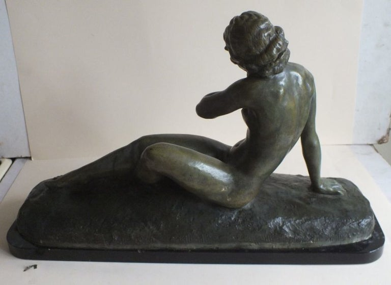 Beautiful and large size bronze by important Art Deco sculptor Cipriani, in lovely green patina. Very beautiful stylized classic reclining nude, with masterfully executed details. Look closely at her lovely face, posture, fingers and feet. She is an