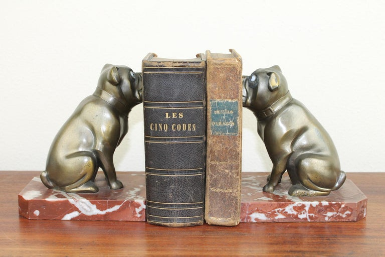 Large size Art Deco figural bookends with French bulldogs by Franjou, France. Both bookends are signed and for the age still in very good condition. The bulldog figurines - dog statues have big expressive eyes. They are made of patinated metal,