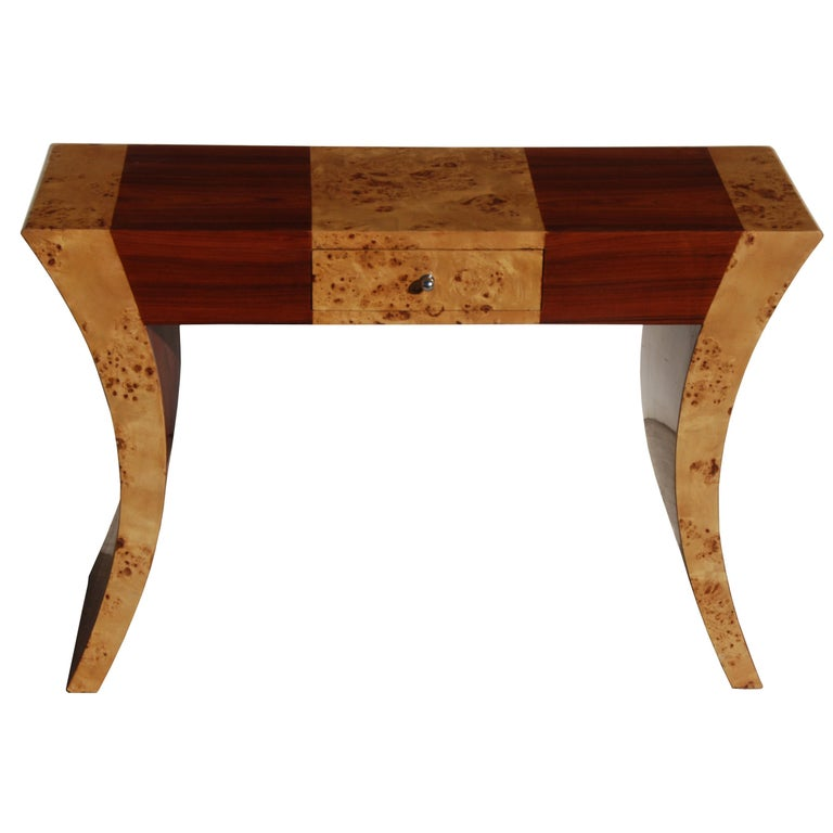 2 Art Deco style console tables  A rich mix of burl and other exotic woods are incorporated in this console.  The back is finished for use in center of room.  One-drawer with metal drawer pull.  Measures: 47