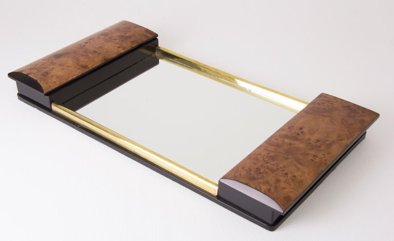 Art deco Mirror glass tray with lacquered burr elm ends which fold out to reveal ebonized compartments. Measures: H 6 cm, W 59 cm, D 30 cm French, circa 1930.