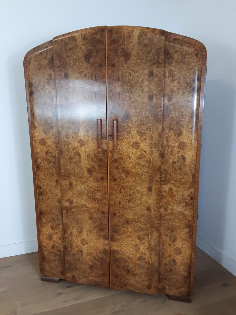 Art Deco bedroom set in a beautiful burr walnut. curved tops to the wardrobe and tallboy, the dressing table with cloud shape mirror. Measures: Wardrobe 192 cm H, 123 cm W, 50 cm D, 47 cm D at the sides where the design steps in. Tall boy 167 cm