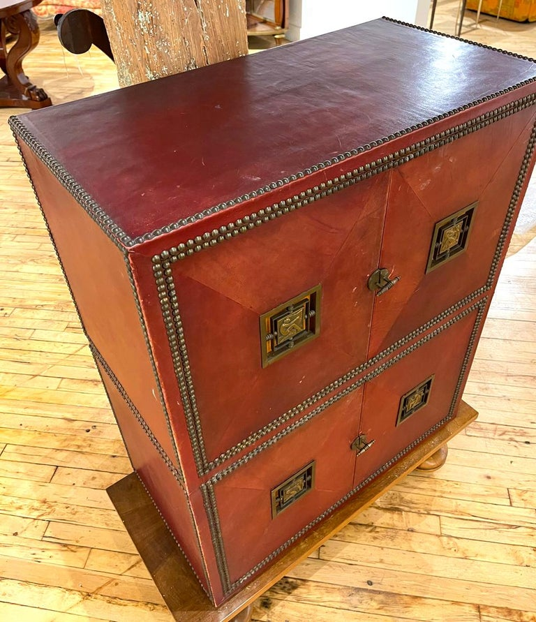 French Art Deco Cabinet in Deep Red Leather, France, with Bronze Mounts by Renard For Sale
