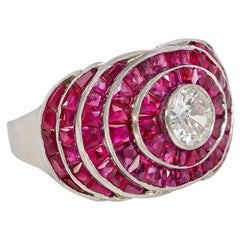 Art Deco Calibré Ruby and Old European Cut Diamond Bombé Ring, in Platinum