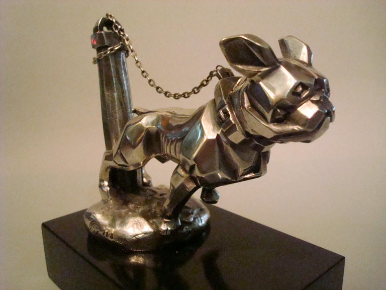 Art Deco 'Chained Bulldog' Car Mascot / Hood Ornament by Marvel, French, 1920´s, marked with foundry stamp number 213, silver-plated bronze, large version, 14cm long, complete with chain. Very nice desk piece of Automobilia.  Some info on the