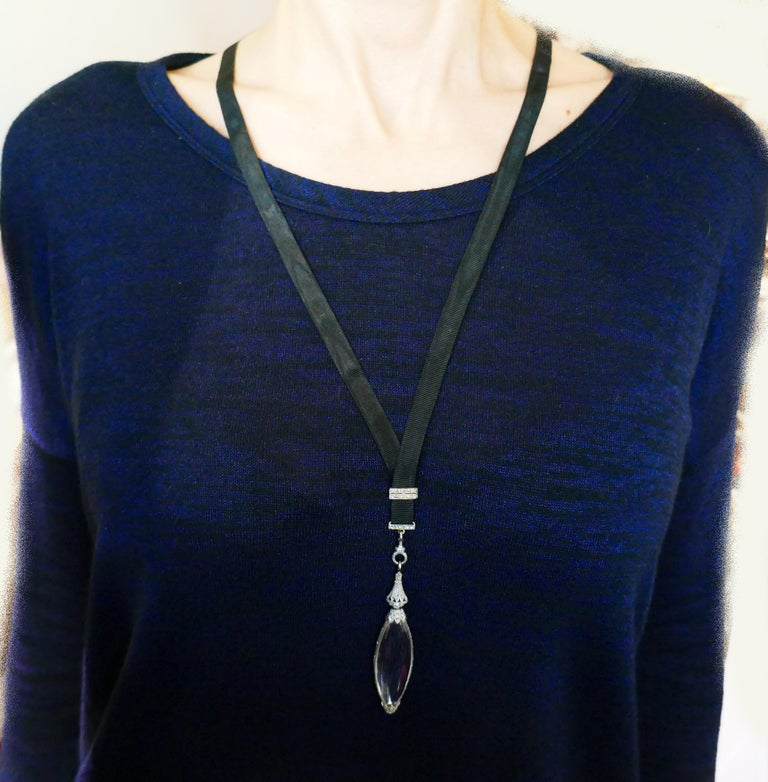 Classy Art Deco pendant on a black satin cord created by Cartier in the 1920s. Understated, elegant, wearable and timeless, the necklace is a great addition to your jewelry collection. Made of platinum (tested), rock crystal and set with single and