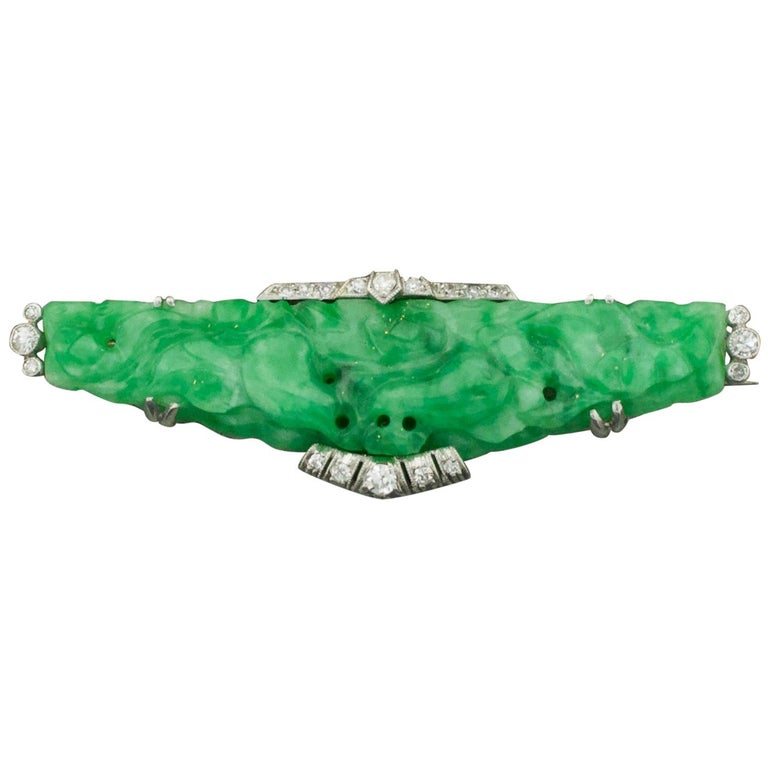 Art Deco Carved Jade and Diamond Brooch in Platinum, circa 1920s For Sale