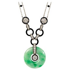 Art Deco Carved Jade, Diamond, Onyx, and Enamel Pendant Necklace in Platinum