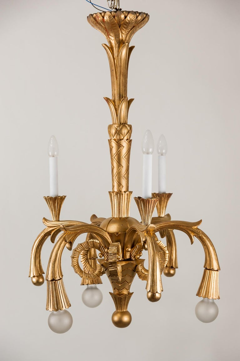 Art Deco carved wood chandelier, 1930s Painted gold color 6 bulbs Original condition.