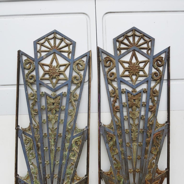 These incredible grates came off of a Los Angeles area building from the 1930s. They show a wonderful overall patina in a two toned finish. Each grate has flat bars on the left and right with mounting holes for easy installation. They can be used in