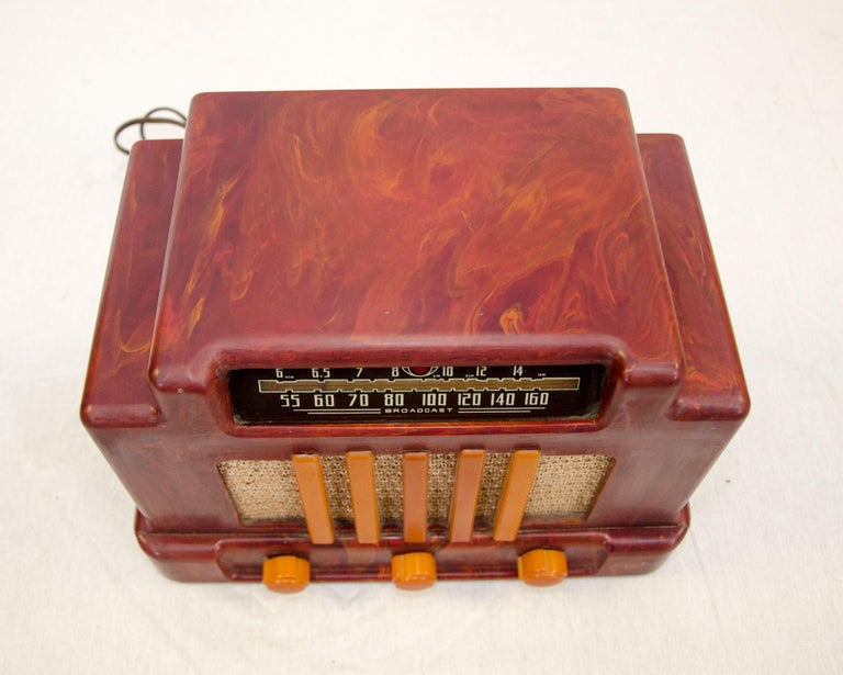 Beautiful vintage mottled red and butterscotch colored Catalin radio. It was manufactured by Addison Industries in Canada. Sometimes referred to as the