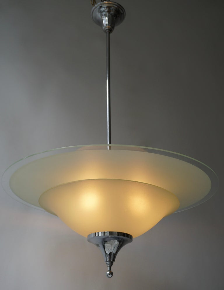 Wonderful and decorative and pendant light in chrome and frosted glass.Designed and made in Belgium from circa 1930s. 