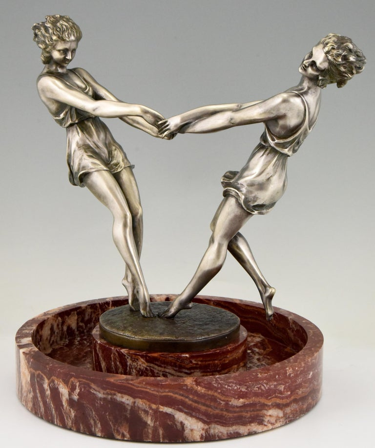 Whirling, spectacular circular marble centerpiece with a bronze sculpture of two dancing girls holding hands by the French artist Andre Gilbert, circa 1925.