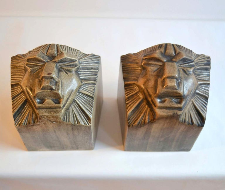 Two original Art Deco ceramic bookends depicting lion heads, attributed to Jan Schonk who designed for Royal pottery factory Gouda.