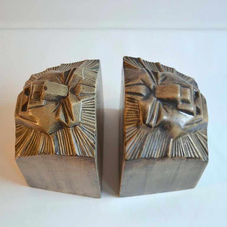 Mid-20th Century Art Deco Ceramic Bookends in the Shape of Lion Heads For Sale