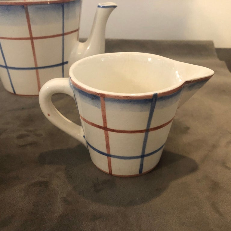 A stylish white ceramic tea set by Giò Ponti, he was the Artistic director of Richard Ginori in the period 1923-1933. The tea set is decorated with red and blue lines and it's in very good condition.