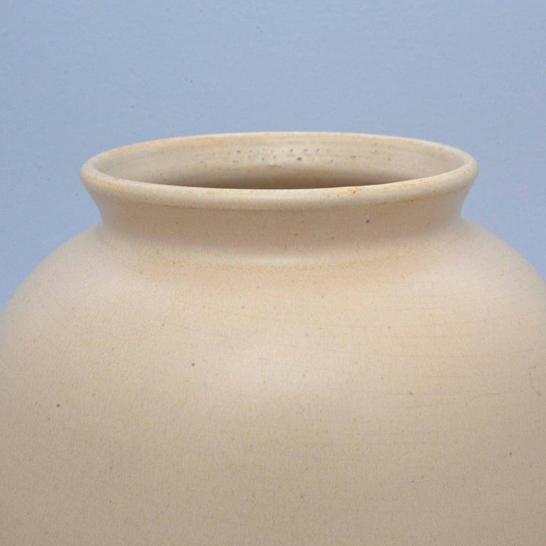 Cream colored ceramic vase produced by Dutch manufacturer ADCO (N.V. Groninger Steenfabrieken).