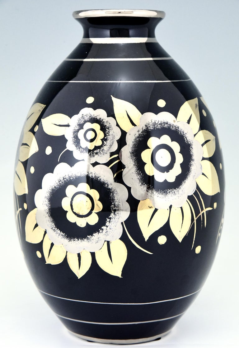 Art Deco vase with flowers in silver and gold on a black shiny glaze by Boch Freres, La Louvière, Belgium, 1936.