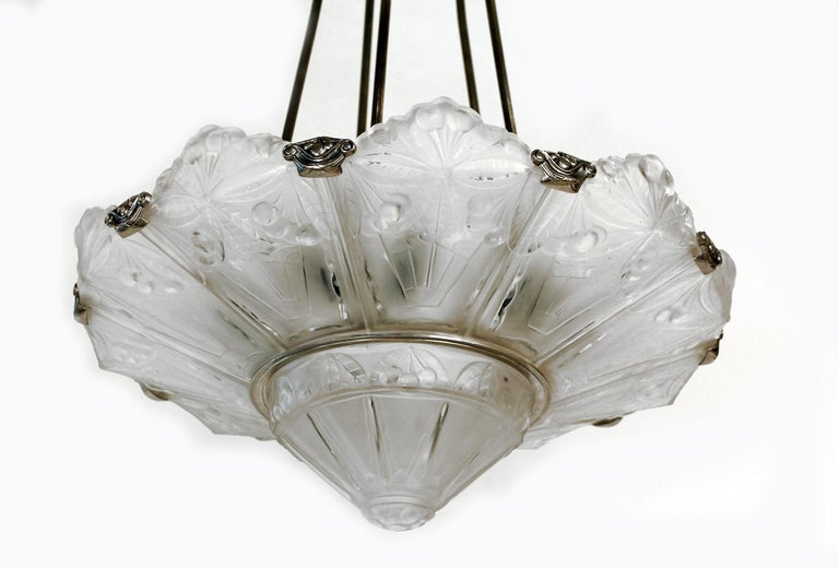 Art Deco chandelier made out a metal frame and frosted molded panels and center plate by Sabino-Paris. Made in France  circa 1930 Signature: Sabino 4797P FRANCE.