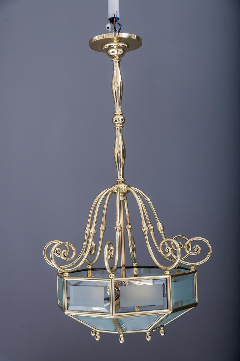 Art Deco chandelier, Vienna, circa 1920s Polished and stove enameled Cut and matt glasses combination.