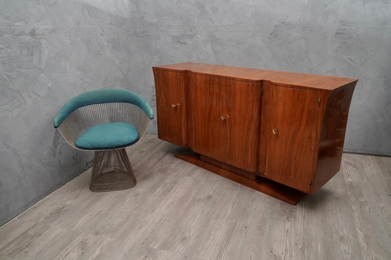 Fantastic patina for this cherry wood sideboard, with a very warm color.  All veneer in cherrywood. Composed of four doors, two side singles and two coupled central doors. The doors do not have a sharp edge but rounded edge. The sides of the
