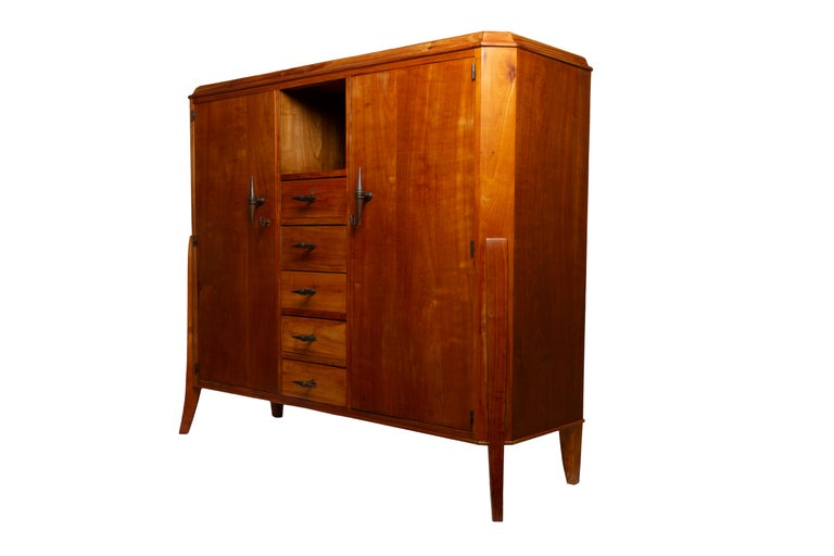 Carefully restored very stylish Art Deco cherrywood veneered sideboard with solid cherrywood details and patinated bronze elements.