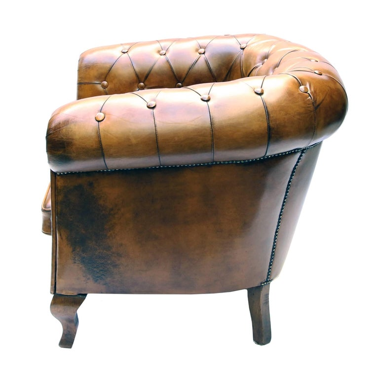 This Art Deco Chesterfield armchair with an original frame of beechwood has been newly upholstered in hand-patinated sheep leather. Very comfortable and extremely robust. Measures: Seat height 44 cm.