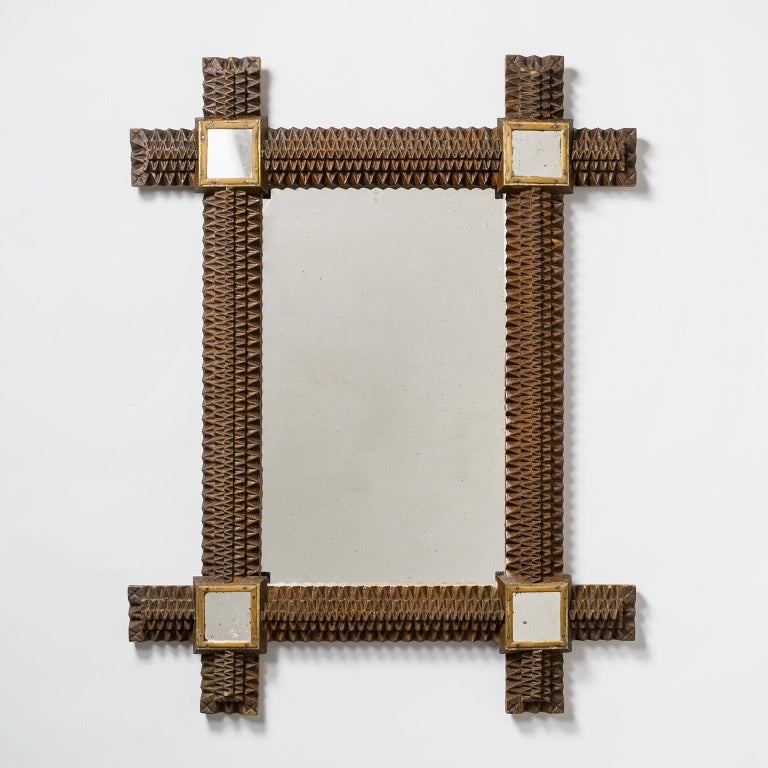 Very fine Art Deco mirror with intricate geometric woodwork. On the top left of the backside it is signed and dated
