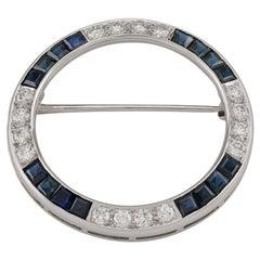Art Deco circa 1925 Platinum J.E. Caldwell Sapphire and Diamond Circle Pin