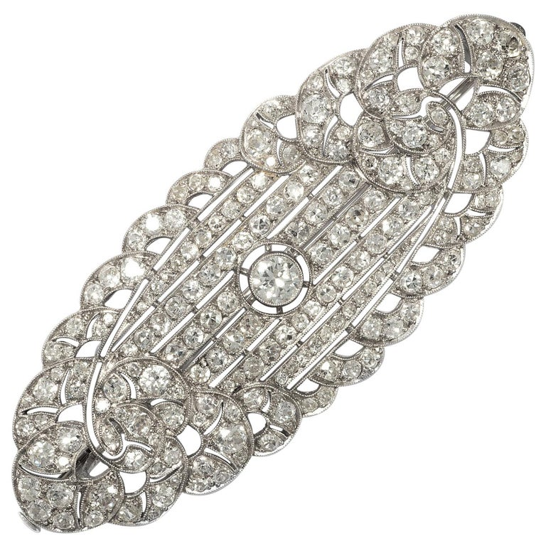 Art Déco circa 1930, Certified 7.3 Carat Diamond and Platinum Filigree Brooch For Sale