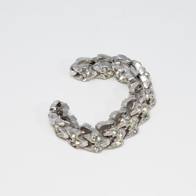 A rhodium-plated link bracelet accented with clear crystals. Fastened with a vintage box clasp mechanism. A brilliant shine!