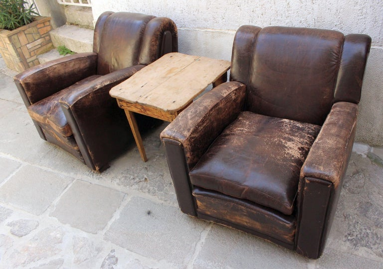 Over size Poltrona Frau pair of chairs. Coil springs make this chair super comfortable.