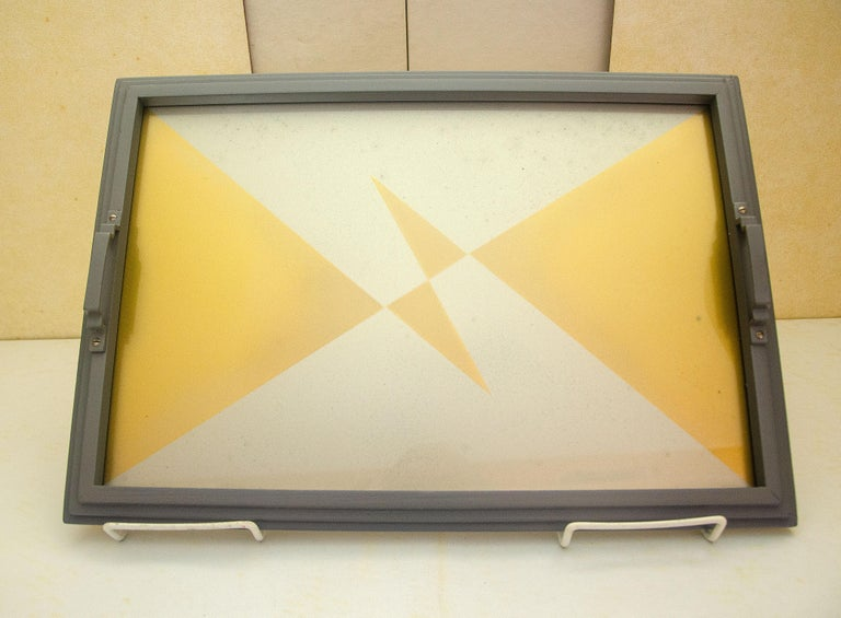 Unusual gold and silver/gray Art Deco geometric graphic design in a restored silver/gray stepped frame with handles. The tray serving space is 15 1/2' x 10 1/4