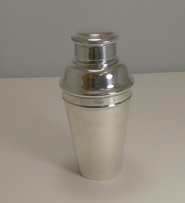 A handsome Art Deco one pint Cocktail Shaker in silverplate. Highly desirable, this one has an integral ice crusher which is revealed once the upper portion is removed.