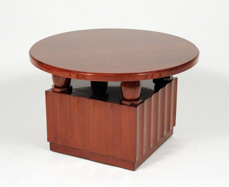 Art Deco rare mahogany veneer coffee table with four carved olive shaped pillars attached to