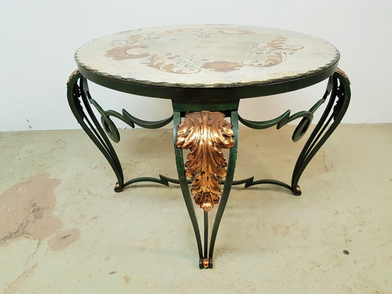 Wrought iron Art Deco table with églomisé Mirror by Rene Drouet, France, 1940. Dark green lacquer, gold leaf details. Mirror signed by artist.