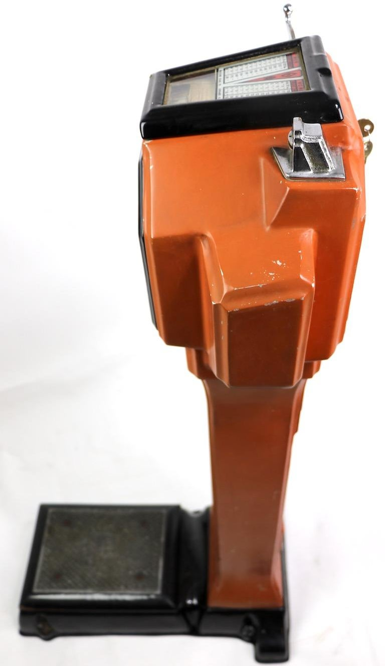 Art Deco coin operated scale, by the Watling Scale Company, of Chicago. This example is in good working condition, showing expected cosmetic wear to finish, normal and consistent with age. Keys included with machine.