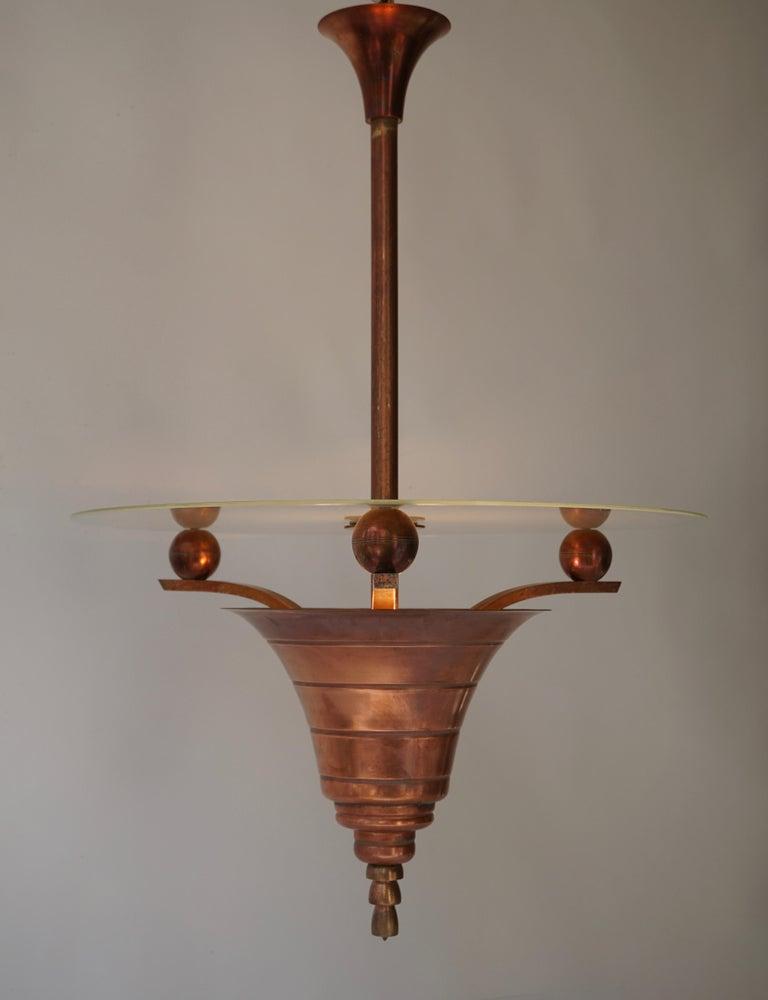 French Art Deco copper chandelier. Measures: Diameter 50 cm. Height 75 cm. 3 E27 bulbs.