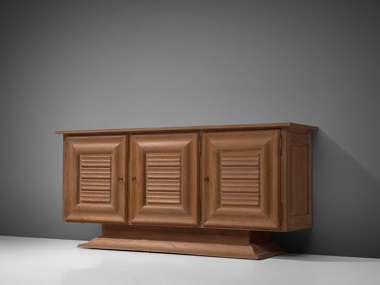 Credenza, in oak and metal, France, 1940s. 