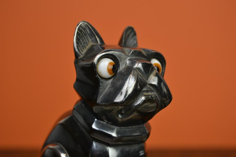 French Art Deco Bookends by H.Moreau (Hippolyte François Moreau) - both Signed. These bookends have French bulldogs - caricature bulldogs - cubist bulldogs mounted on marble bases. This chromed spelter dogs still have their original glass bulging