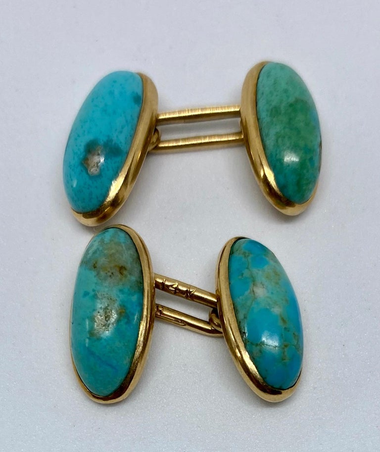 Rare, highly unusual, elongated oval cufflinks featuring four bright blue turquoise cabochons in 14K rose gold settings by Larter & Sons.  The oval faces each measure 16mm by 8mm; together, the cufflinks weigh 6.93 grams.  They bear the Larter &