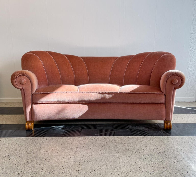 This sofa was made in the 1930s Sweden. The curves and structure on this furniture takes you back to the art deco period. It's in its original fabric. Nails attached to the sofas back and wooden lacquered legs.   Nice vintage condition.