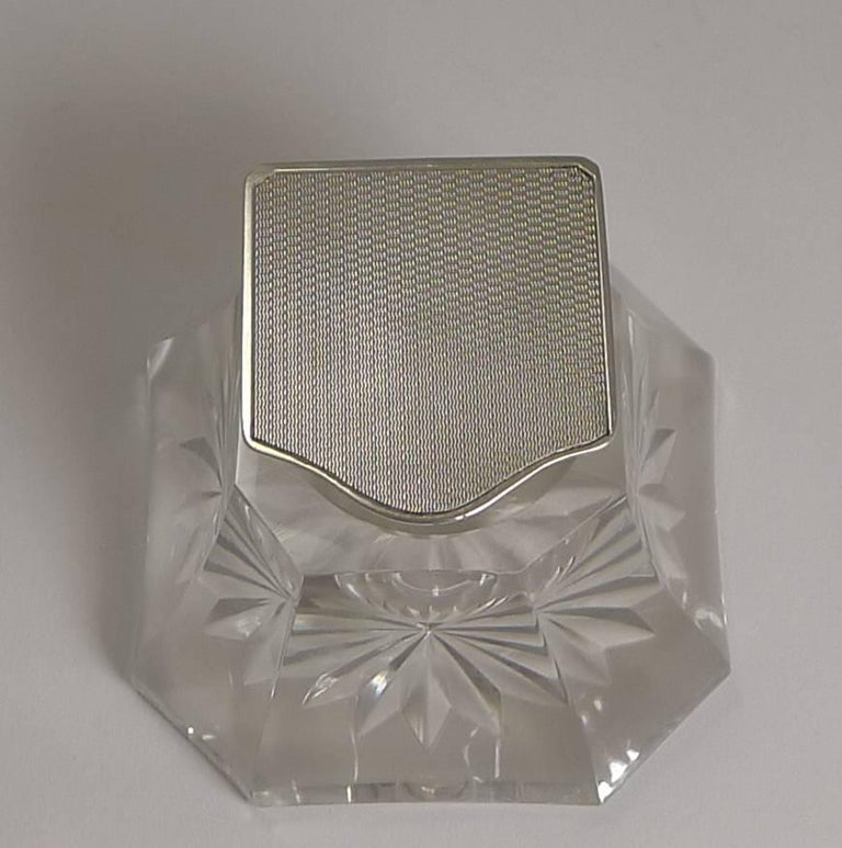 A really handsome vintage art deco inkwell, beautifully shaped and star cut on the underside. The collar and hinged lid is made from sterling silver and the top of the lid beautifully engine turned.  The silver is fully hallmarked for Birmingham