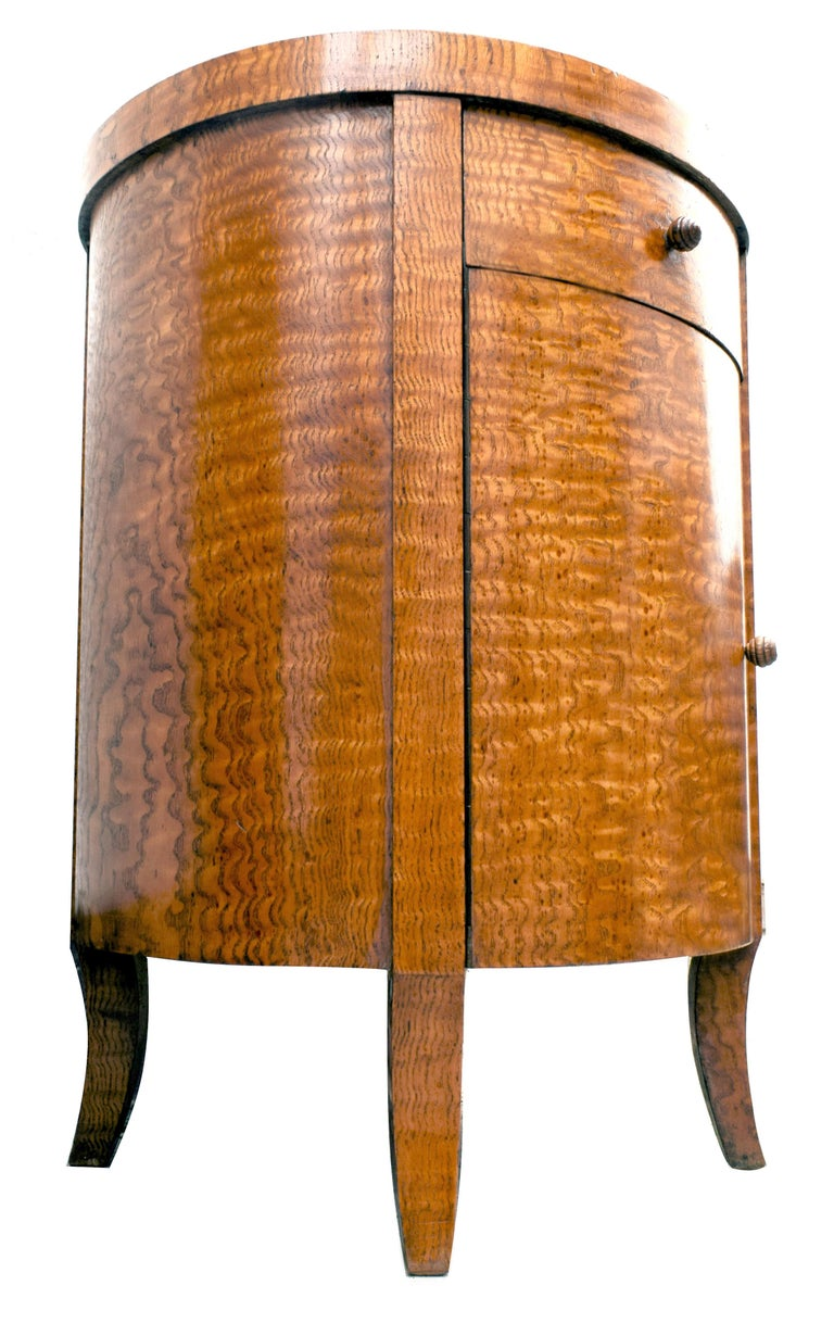 For your consideration is this hugely stylish and rare Art Deco circular cabinet in the rare veneers of Chinese burl ash, a very expensive wood of its time and consequently rarely used or seen. Blonde in tone this piece easily integrates with other