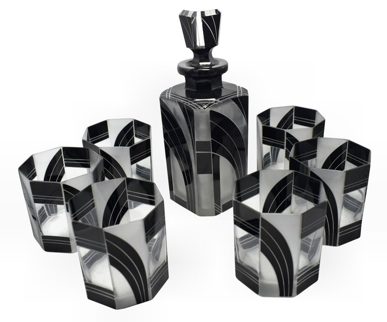 Very high quality, very striking looking 1930s Art Deco Czech glass decanter set. Features a Classic shape decanter with stopped and six decent sized glass tumblers. The whole set is enameled in black with etching to highlight the detailing and