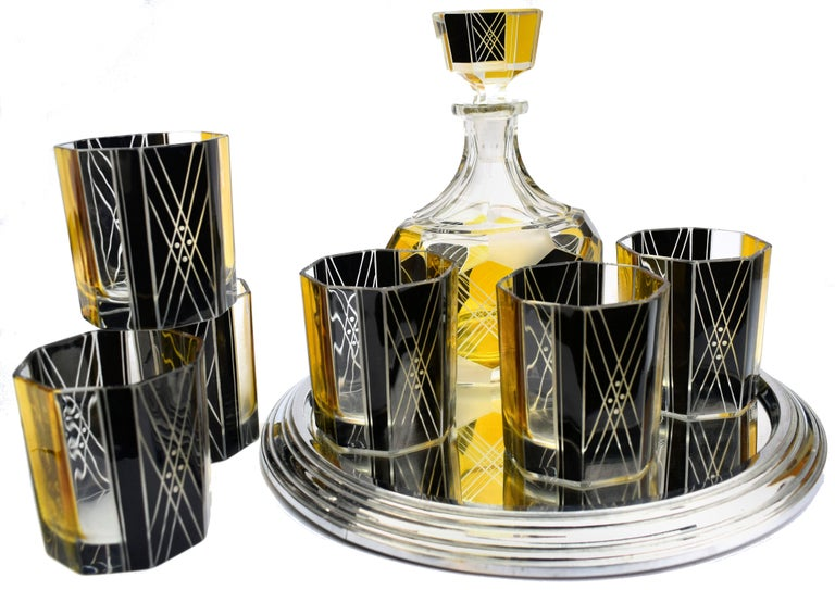 Very high quality, very striking looking 1930s Art Deco Czech glass decanter set. Features a Classic shape crystal decanter with stopper and six decent sized glass tumblers. The whole set is enameled in yellow and black with etching to highlight the