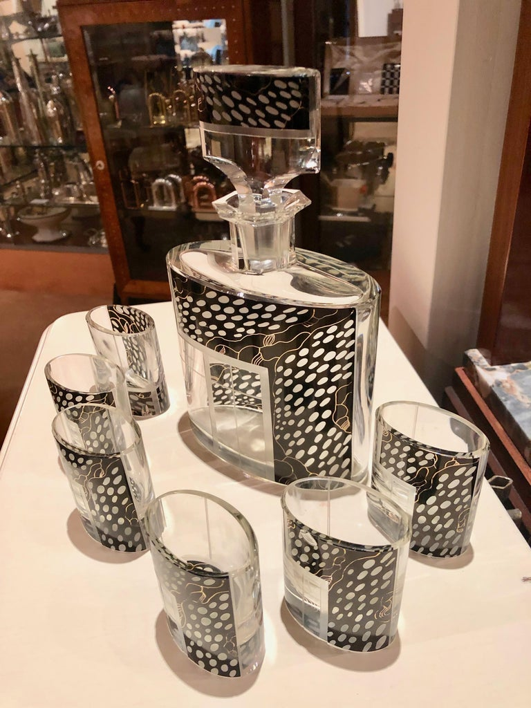 A jazzy Czechoslovakian decanter set embellished with Avant Garde leopard black in a decidedly asymmetric pattern unusual in its time. This handsome piece with matching glasses is in near perfect condition. This unique set has a lot going on for it.
