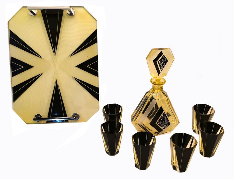 Very high quality, very striking looking 1930's Art Deco Czech glass decanter set. Features a classic shape decanter with large over sized stopper and six decent sized shot glasses and if that wasn't enough it even has a matching tray. The tray