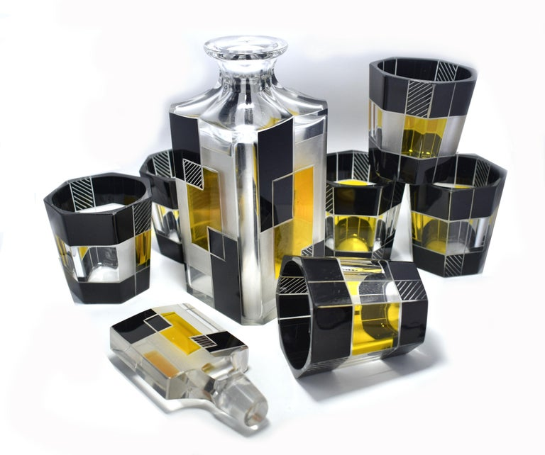 Very high quality, very striking looking 1930s Art Deco Czech glass decanter set. Features a Classic shape decanter with stopped and six decent sized glass tumblers . The whole set is enameled in yellow and black with etching to highlight the